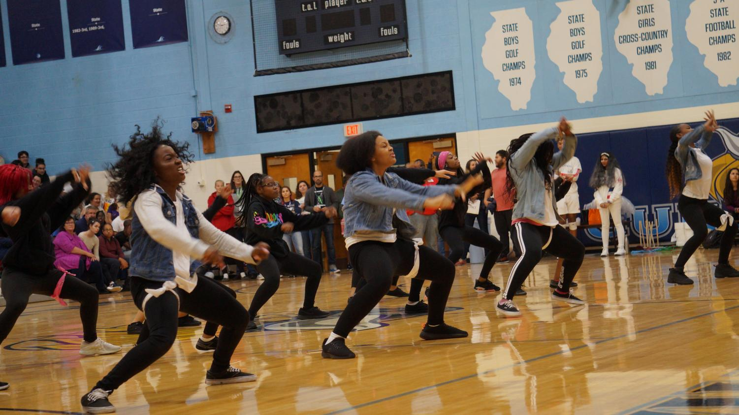 Workin' it. Dance team energizes crowd at Homecoming pep rally