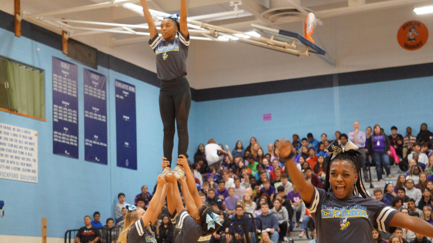 Reach for the Sky: Cheerleaders perform at Homecoming pep rally