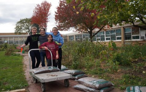 Mulch Ado About Something: Student Ambassadors Tim Morris, Evan Click, Vanessa Silva & Tyler McGinnis help beautify courtyard