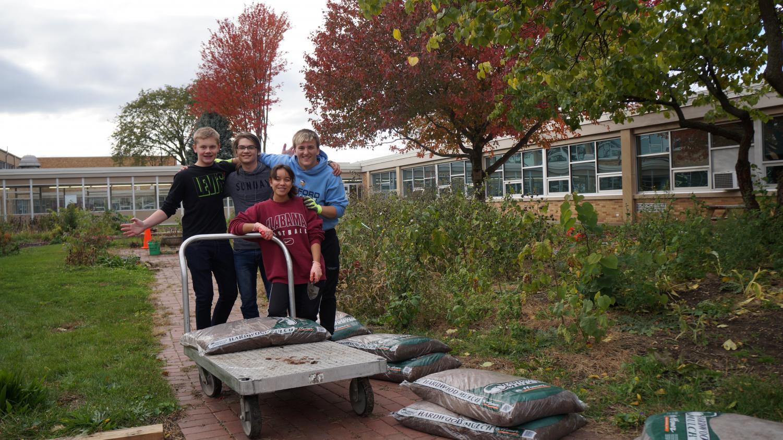 Mulch Ado About Something: Student Ambassadors Tim Morris, Evan Click, Vanessa Silva & Tyler McGinnis help beautify courtyard