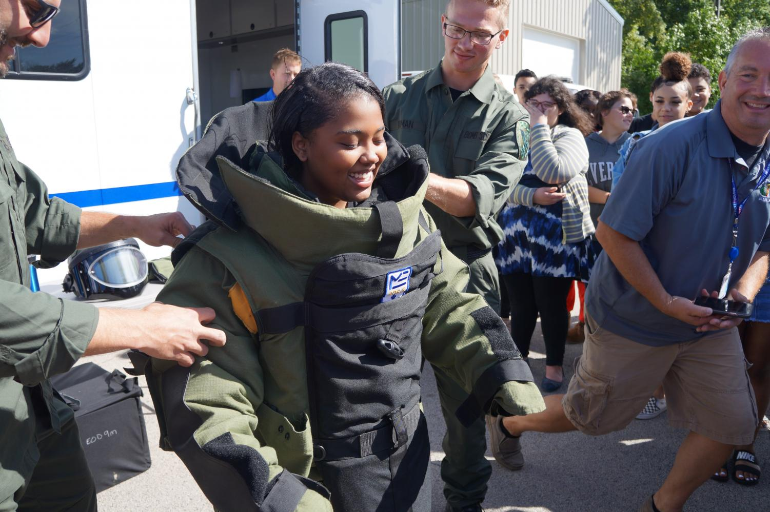 You da Bomb! Nevaeh Prunty, senior, dons an explosion-protective outfit worn by bomb squad police during Mr. Barabas' Criminology class on September 12.
