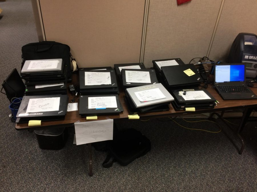 Scrubbed clean: Teachers' laptops await pickup after hard drive replacements and loss of innumerable documents.