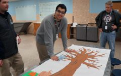 "Diego Diaz Deleon, 12, adds the first leaf to the Inclusion Club's ""Things we are Grateful For"" tree"