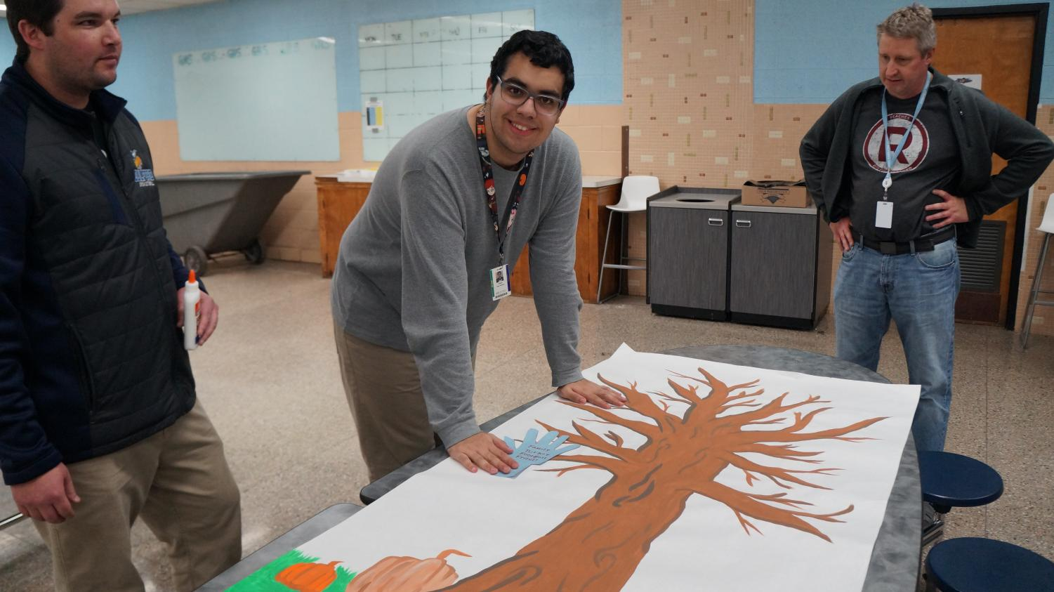 """Diego Diaz Deleon, 12, adds the first leaf to the Inclusion Club's """"Things we are Grateful For"""" tree"""