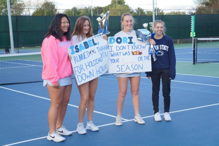 Senior night : Isabel Runne & Dori Russo display posters created by Maggie Thomas & Kacey Accut
