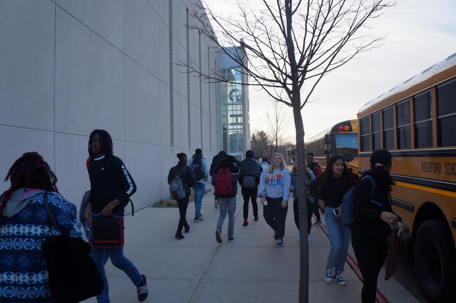 Students make their way from the new bus drop-off to the main entrance.