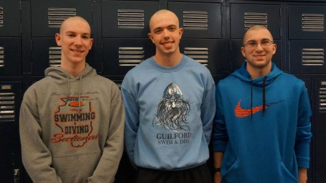 Swimmers Ian Burley, Jacob Stroup,and Nolan Steingraber display their shaved heads following the Boys Swim Team tradition of bleaching their hair white for a week late in the season.