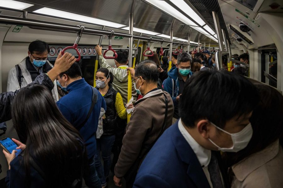 People on a train wearing face masks during the Coronavirus outbreak. Credit: the New York Times