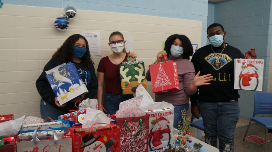 Student Council members Shayla Bonnett, Abby Foster, Azelia Hinton and Martez Lockhart distribute treat bags to teachers to give to their children.