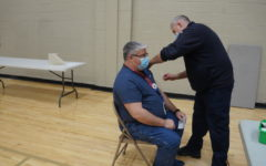 Mr. Scott Fabert-Church, French teacher, gets his second COVID vaccination at Jefferson High School on March 12.