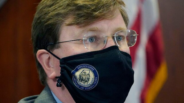 Mississippi Gov. Tate Reeves wears a face mask as he listens to Mississippi State Health Officer Dr. Thomas Dobbs, unseen, answer a question during the governor's COVID-19 briefing for reporters in Jackson, Miss., Monday, Jan. 4, 2021. (AP Photo/Rogelio V. Solis) (Source: Rogelio V. Solis)