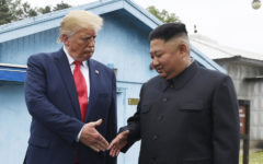 FILE - In this June 30, 2019, file photo, North Korean leader Kim Jong Un, right, and U.S. President Donald Trump prepare to shake hands at the border village of Panmunjom in the Demilitarized Zone, South Korea. North Korea said it's running out of patience with the United States over what it described as hostile policies and unilateral disarmament demands. It's warning that a close personal relationship between their leaders alone wouldn't be enough to prevent nuclear diplomacy from derailing. (AP Photo/Susan Walsh, File)