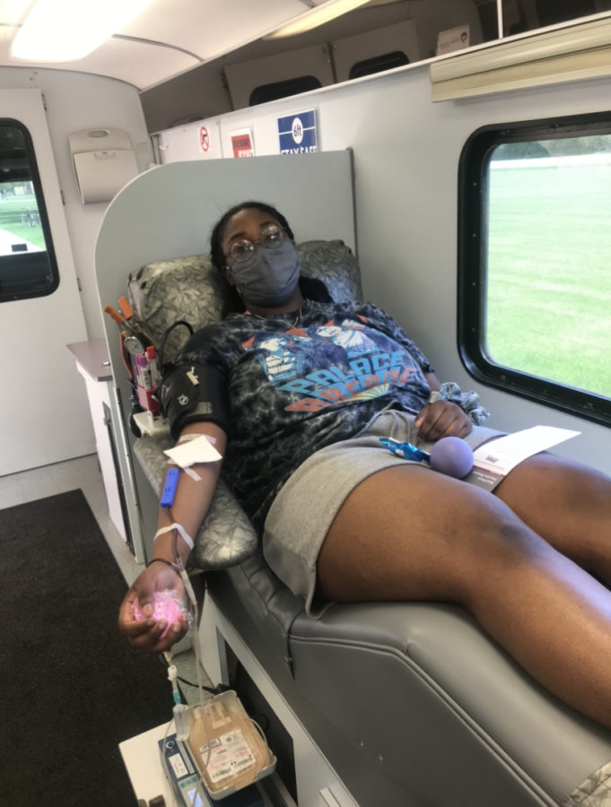Features Editor Zania Harris donates blood in the Rock River Valley Blood Center mobile unit.