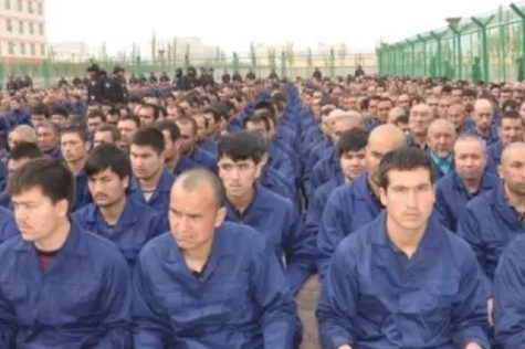 Government social media post in April 2017 shows detainees in a camp in Hotan Prefecture [Image obtained by HRW] Credit: Al Jazeera