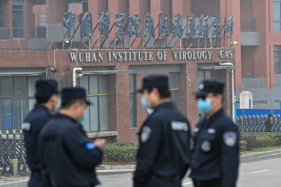 Security personnel stand guard outside the Wuhan Institute of Virology in Wuhan as members of the World Health Organization (WHO) team investigating the origins of the COVID-19 coronavirus make a visit to the institute in Wuhan in Chinas central Hubei province on February 3, 2021. (Photo by Hector RETAMAL / AFP) (Photo by HECTOR RETAMAL/AFP via Getty Images)