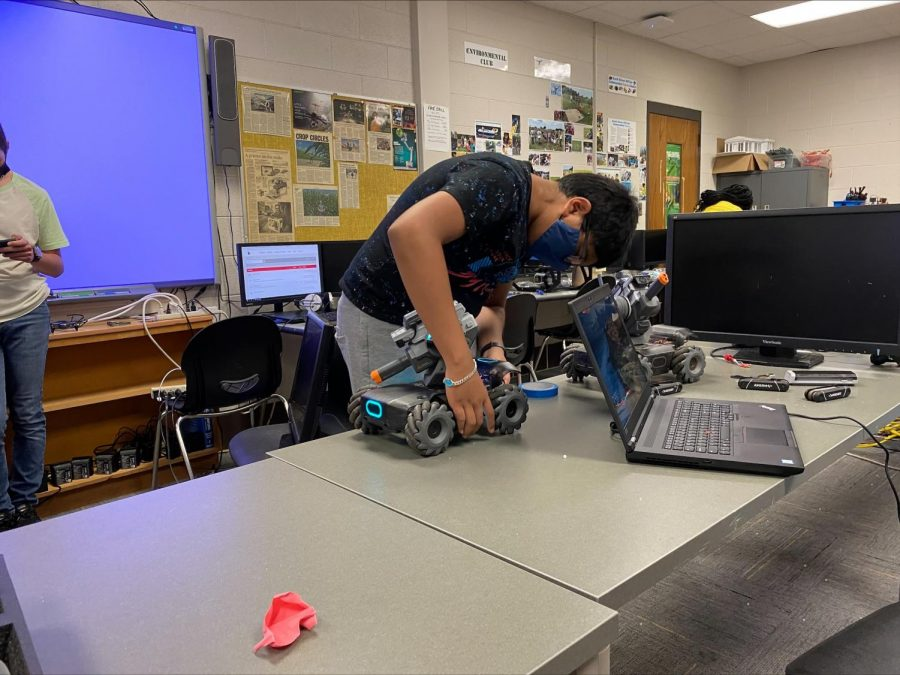 Vedant Patel, a freshman at Auburn High School, assembles one of the Robomasters.